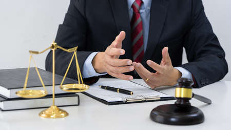 Professional Secretary lawyer working at his office signing contract Consultation of client from trust Law Firm, Attorneys Notary Law and Legal services concept.