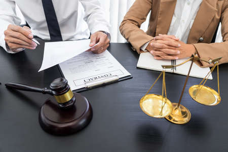 lawyer or judge meeting with client consulting help discussing contract paper agreement