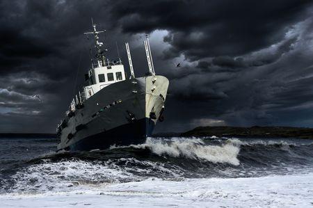 Ship on the storm sea photo
