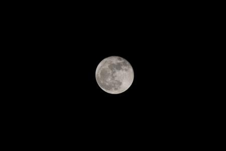 a full moon in the night sky 写真素材