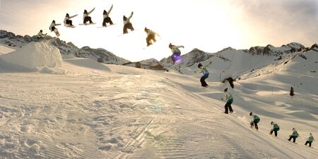 snowboard girl do a 360 lien in a snowpark switzerland Stock Photo