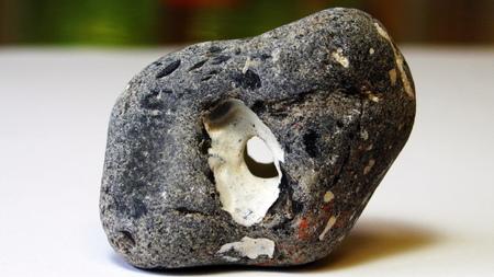 flint: Stone with hole Flint black knows breakthrough