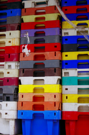 fisheries: Colorful stacked plastic containers fisheries Stock Photo
