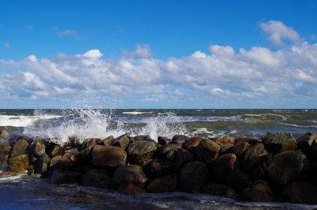 Wave over breakwater on the Baltic Sea
