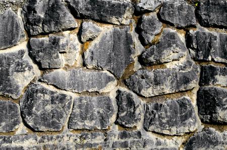 demarcation: Wall of natural stone Stock Photo