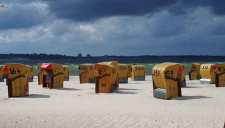 Beach chairs on the beach of Laboe near Kiel bad weather day