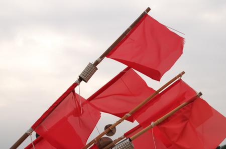 Red Fisherman Flags Standard-Bild - 99779041
