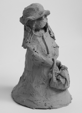 Clay figure of a small girl from art therapy Standard-Bild