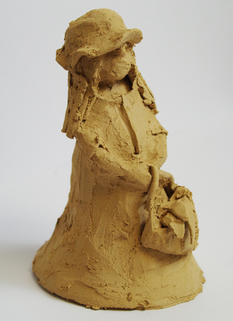 Clay figure of a small girl from art therapy Standard-Bild - 112715540
