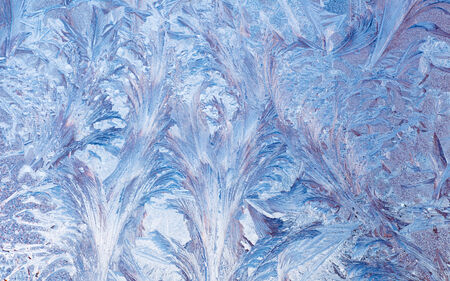 Macro of abstract frost pattern on window. photo
