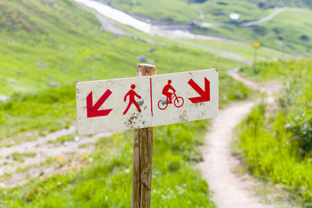 Sign of pedestrians on the left trail, and cyclists on the right. Tignes, French Alps. photo