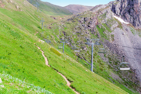 bike trail: Mountain bike trail running along the chair lift. Tignes, French Alps. Stock Photo