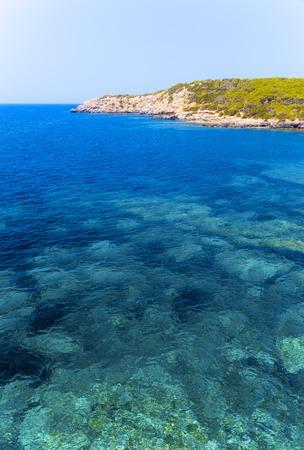 tyrrhenian: Clear water and rocky shore of the Tyrrhenian Sea in Sardinia, Italy.