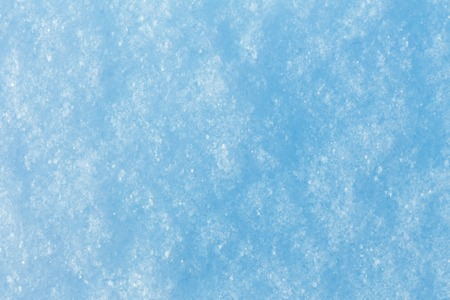 The texture of the snow surface closeup. The softness, purity, winter concept.