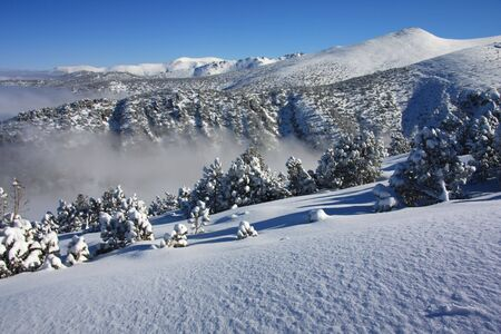 Winter landscape and fog in the mountain Stock Photo