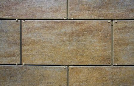 Ceramic granite wall tiling. Close up Stock Photo