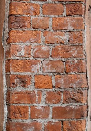 Rough and weathered old dirty brick wall Stock Photo