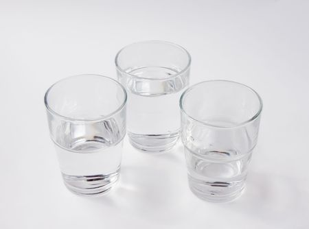 közel: Three glasses of water - one nearly empty, one half full, one almost full  Stock fotó