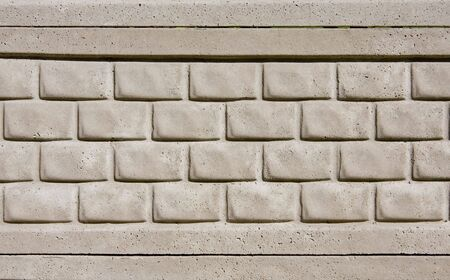 Gray concrete textured tiled brick wall