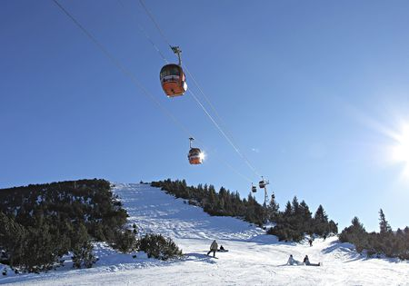 Cable car over mountain landscape. Rila mountains, ski resort Borovets, Bulgaria