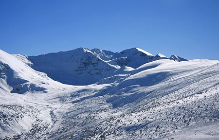 Panorame of winter mountains. Alpine ski resort Borovets, Bulgaria
