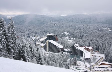 Ski resort Borovets, Bulgaria. Hotel complex and panorama of winter mountains photo