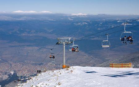 Chair ski lift and panorama of ski resort Bansko, Bulgaria Stock Photo - 6476278