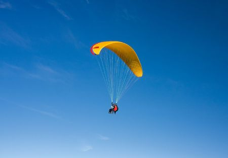 parasailing: Paragliding in Bulgaria over the mountains against clear blue sky Stock Photo