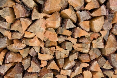 Chopped pine fire wood background photo