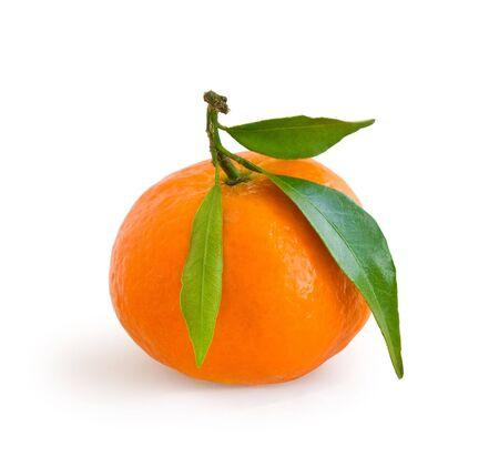 Fresh tangerine on stem with green leaves isolated on white Stock Photo