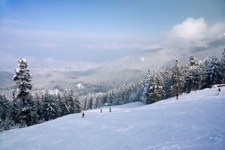 Ski slope and winter mountains panorama. Resort Bansko, Bulgaria