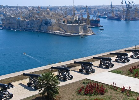 View to Grand Harbour and medieval cannons from Valetta wall, Mlalta