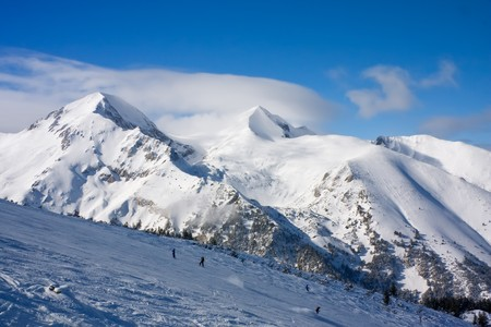 Panorama of winter mountains. Alpine ski resort Bansko, Bulgaria Stock Photo