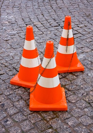 Safety Traffic Cones on granite pavement photo