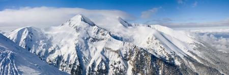 Panorama of winter mountains. Alpine ski resort Bansko, Bulgaria photo