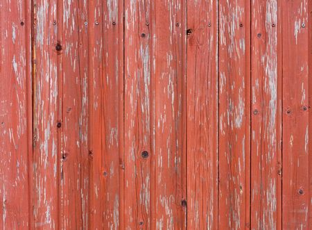 Red color plank background of old weathered wood