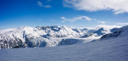 Ski slope and panorama of winter mountains. Alpine ski resort Bansko, Bulgaria Stock Photo - 10509162