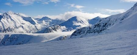 Ski slope and panorama of winter mountains. Alpine ski resort Bansko, Bulgaria Stock Photo