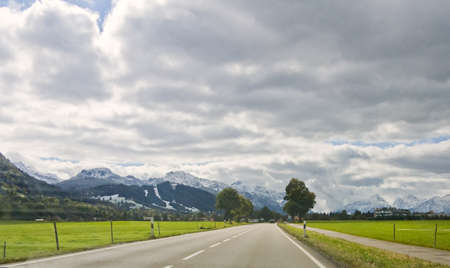 View to the road and mountain landscape. Bavarian Alps, Germany photo