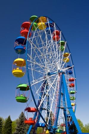 Ride on Ferris wheel in Amusement Park Editorial