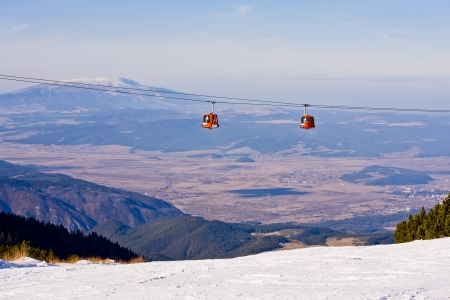 Cable car ski lift over mountain landscape. Rila mountains, ski resort Borovets, Bulgaria