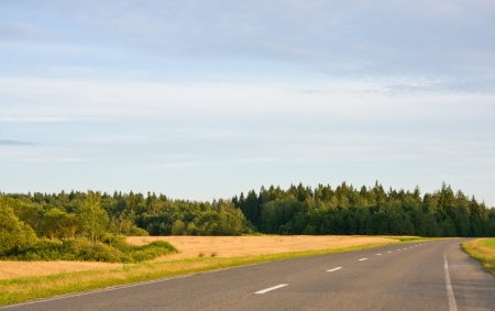 road marking: Empty country road in rural landscape Stock Photo