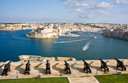 View to Vittoriosa Harbor and medieval cannons battery from Valetta wall, Malta Stock Photo