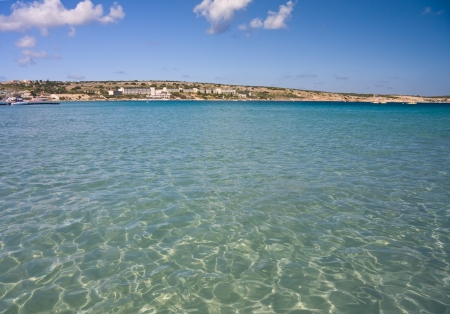 Famous Mellieha bay on Malta. View from the sea photo