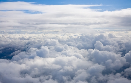 Panorama above the clouds. Aerial view from the plane