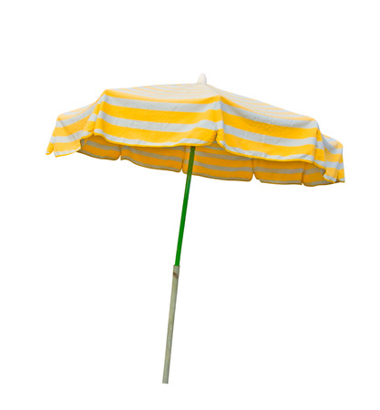 Yellow and gray striped beach umbrella isolated on white with clipping path photo