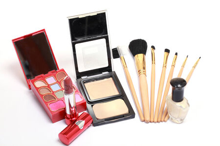 neutrals: Make-up kit and brushes on whited background Stock Photo
