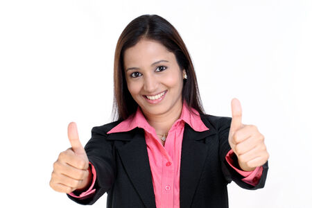 thumbs up woman: Smiling businesswoman showing thumbs up isolated against white background