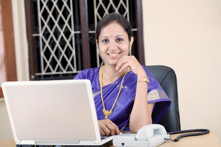 Indian traditional business woman working at the office 版權商用圖片