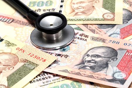 rupee: Closeup of Stethoscope on Indain rupee notes Stock Photo